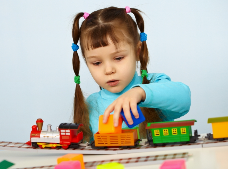 2677071-little-girl-preschooler-playing-with-toy-railway